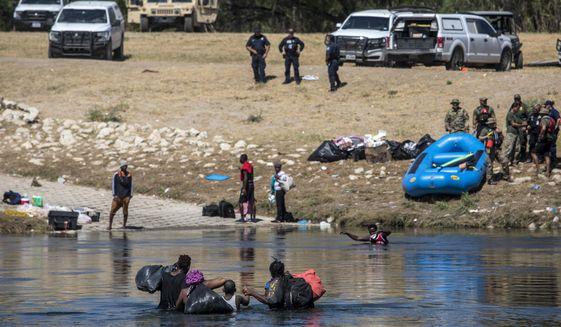 Migrants cross the Rio Grande toward Del Rio, Texas, from Ciudad Acuña, Mexico, Thursday, Sept. 23, 2021. (AP Photo/Felix Marquez) ** FILE **