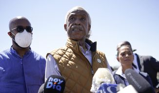 The Rev. Al Sharpton, center, speaks to reporters after touring an encampment of migrants, mostly from Haiti, along the Del Rio International Bridge, Thursday, Sept. 23, 2021, in Del Rio, Texas. (AP Photo/Julio Cortez)