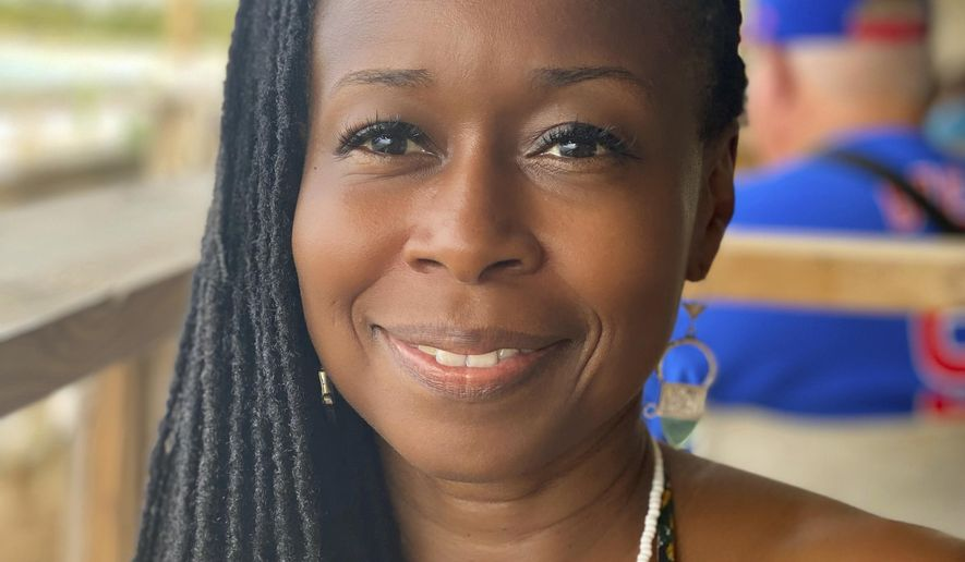 """This 2021 selfie photo shows Monifa Bandele. Bandele, who has taken interim leadership of Time's Up, says the organization is undergoing a structural review and will emerge with a new openness and a focus on """"people power,"""" with leadership that includes farm, restaurant and domestic workers. (Monifa Bandele via AP)"""