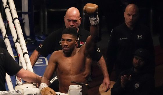 Anthony Joshua of Britain waves to spectators after his defeat to Oleksandr Usyk of Ukraine in their WBA (Super), WBO and IBF boxing title bout at the Tottenham Hotspur Stadium in London, Saturday, Sept. 25, 2021. (AP Photo/Frank Augstein) **FILE**