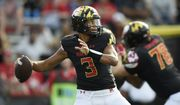 Maryland quarterback Taulia Tagovailoa throws a pass against Kent State in the first half of an NCAA college football game Saturday, Sept. 25, 2021, in College Park, Md. (AP Photo/Gail Burton)