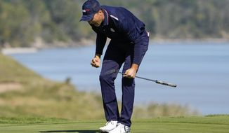 Team USA's Jordan Spieth reacts after making a putt on the 16th hole during a foursomes match the Ryder Cup at the Whistling Straits Golf Course Saturday, Sept. 25, 2021, in Sheboygan, Wis. (AP Photo/Jeff Roberson)