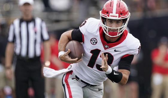 Georgia quarterback Stetson Bennett scrambles against Vanderbilt in the first half of an NCAA college football game Saturday, Sept. 25, 2021, in Nashville, Tenn. (AP Photo/Mark Humphrey)