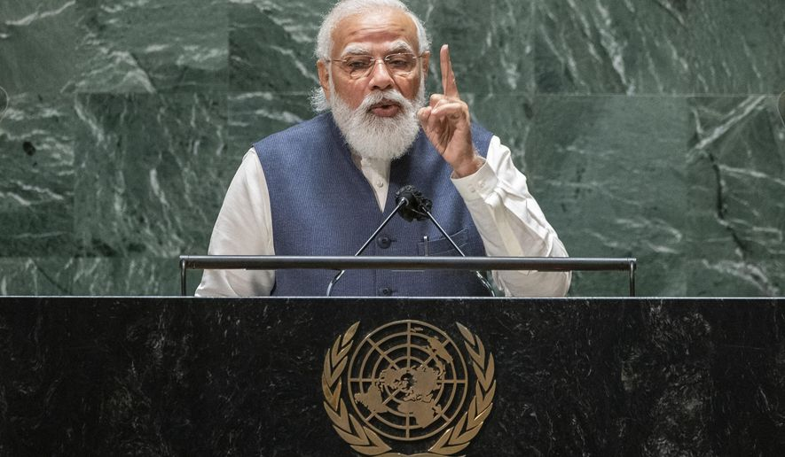 India's Prime Minister Narendra Modi addresses the 76th Session of the U.N. General Assembly at United Nations headquarters in New York, on Saturday, Sept. 25, 2021. (Eduardo Munoz /Pool Photo via AP)