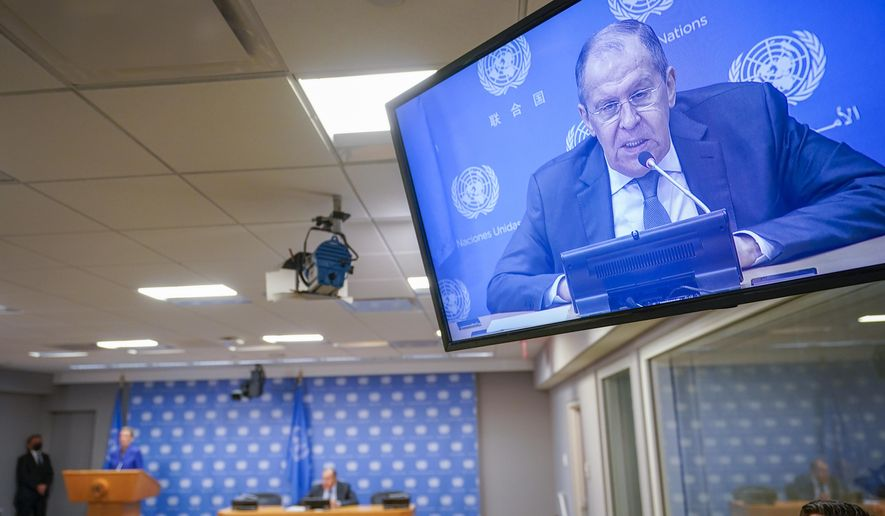 Russian Foreign Minister Sergey Lavrov is seen on a video screen as he speaks to reporters during a news conference during 76th session of the United Nations General Assembly, Saturday, Sept. 25, 2021, at United Nations headquarters. (AP Photo/Mary Altaffer)