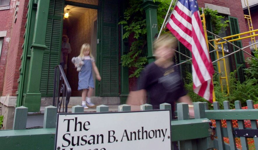Tourists exit the Susan B. Anthony House after taking a tour of the house in Rochester, N.Y., July 28, 2004. The brick house at 17 Madison St. is a highlight in a trail of memorials and museums from New England south to Washington that extoll women's achievements in molding the nation. (AP Photo/David Duprey)
