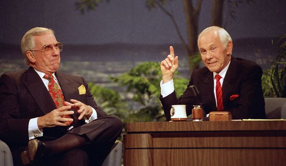 """Host Johnny Carson, right, with announcer Ed McMahon during the final taping of the """"Tonight Show"""" on May 22, 1992. (AP Photo/Douglas C. Pizac, File)"""