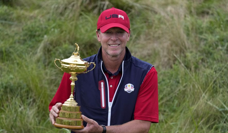 Team USA captain Steve Stricker poses with the trophy after the Ryder Cup matches at the Whistling Straits Golf Course Sunday, Sept. 26, 2021, in Sheboygan, Wis. (AP Photo/Ashley Landis) **FILE**