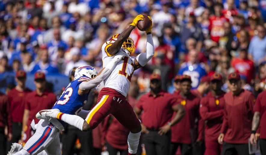 Washington Football Team wide receiver Terry McLaurin (17) makes a pass reception against Buffalo Bills strong safety Micah Hyde (23) during the second quarter of an NFL football game, Sunday, Sept. 26, 2021, in Orchard Park, N.Y. (AP Photo/Brett Carlsen) **FILE**