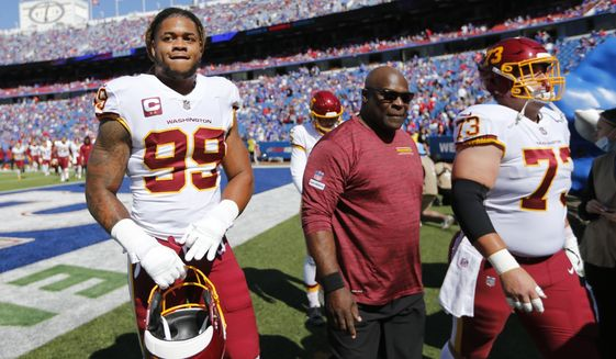 Washington Football Team defensive end Chase Young (99) and center Chase Roullier (73) leaves the field before an NFL football game against the Buffalo Bills Sunday, Sept. 26, 2021, in Orchard Park, N.Y. (AP Photo/Jeffrey T. Barnes)