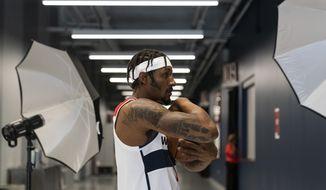 Washington Wizards guard Bradley Beal (3) poses during the NBA basketball team's Media Day, Monday, Sept. 27, 2021, in Washington. (AP Photo/Alex Brandon)