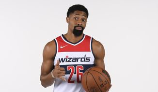 Washington Wizards guard Spencer Dinwiddie poses for a photograph during an NBA basketball media day, Monday, Sept. 27, 2021, in Washington. (AP Photo/Nick Wass) **FILE**