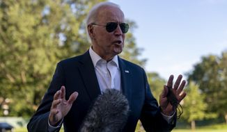 President Joe Biden stops to speak to members of the media as he arrives at the White House in Washington, Sunday, Sept. 26, 2021, after returning from a weekend at Camp David. (AP Photo/Andrew Harnik)