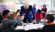 In this Sept. 10, 2021, file photo, President Joe Biden talks to students at Brookland Middle School in Washington, as first lady Jill Biden talks with science teacher Michelle Taylor, right rear. (AP Photo/Manuel Balce Ceneta, File)