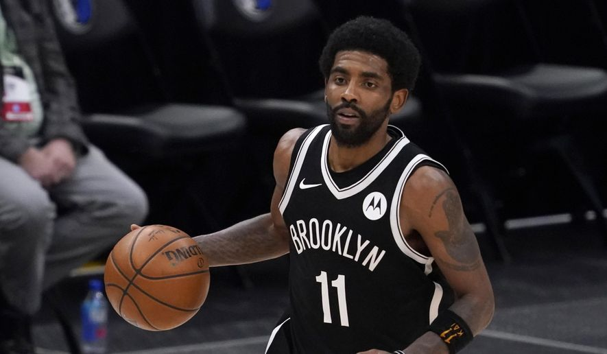 Brooklyn Nets guard Kyrie Irving handles the ball during an NBA basketball game against the Dallas Mavericks in Dallas, in this Thursday, May 6, 2021, file photo. Unable to attend the Brooklyn Nets' media day, Kyrie Irving asked for privacy Monday when pressed about his vaccination status and availability for home games. (AP Photo/Tony Gutierrez) ** FILE **