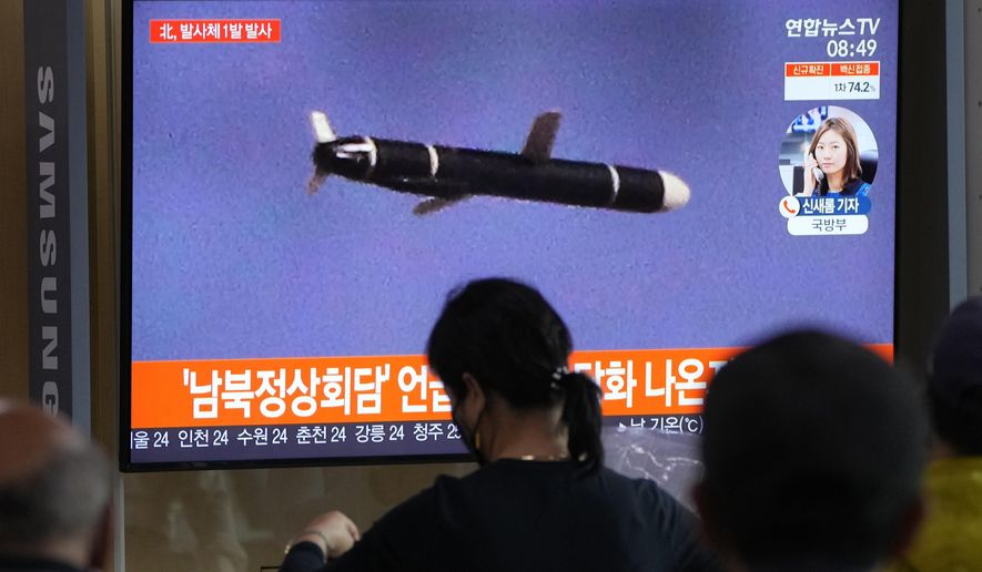 """People watch a TV showing a file image of North Korea's missile launch during a news program at the Seoul Railway Station in Seoul, South Korea, Tuesday, Sept. 28, 2021. North Korea on Tuesday fired a suspected ballistic missile into the sea, Seoul and Tokyo officials said, the latest in a series of weapons tests by Pyongyang that raised questions about the sincerity of its recent offer for talks with South Korea. The Korean letters read: """"After the announcement of the inter-Korean talks."""" (AP Photo/Ahn Young-joon) ** FILE **"""