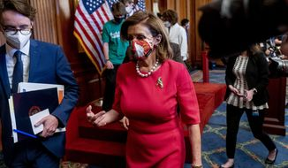 """House Speaker Nancy Pelosi of Calif., leaves a news conference on the Democrat's """"Build Back Better on Climate"""" plan on Capitol Hill in Washington, Tuesday, Sept. 28, 2021. (AP Photo/Andrew Harnik)"""