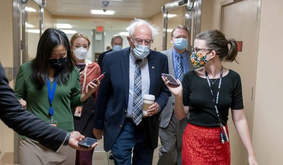 Sen. Bernie Sanders, Vermont independent., arrives at the U.S. Capitol for votes, Wednesday, Sept. 29, 2021, in Washington. (AP Photo/Andrew Harnik)