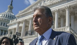 Sen. Joe Manchin, D-W.Va., a centrist Democrat vital to the fate of President Joe Biden's $3.5 trillion domestic agenda, is surrounded by reporters outside the Capitol in Washington, Wednesday, Sept. 29, 2021. Manchin and other senators were boarding a bus to attend a memorial service for the late Susan Bayh, the wife of former Senator Evan Bayh of Indiana, who died earlier in the year. (AP Photo/J. Scott Applewhite)
