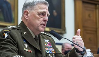 """In this file photo, Chairman of the Joint Chiefs of Staff Gen. Mark Milley testifies before the House Armed Services Committee on Wednesday, Sept. 29, 2021, on Capitol Hill in Washington. Gen. Milley has insisted there was """"a significant degree of intelligence"""" indicating the Chinese military was on alert for a U.S. attack in October 2020 in the hectic run-up to the November U.S. presidential election, a claim disputed by civilian defense officials who served in the Trump administration. (Rod Lamkey/Pool via AP)  **FILE**"""