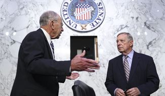 Senate Judiciary Committee Ranking Member Sen. Chuck Grassley, R-Iowa, left, speaks with Chairman Sen. Dick Durbin, D-Ill., prior to a Senate Judiciary Committee hearing to examine Texas's abortion law, Wednesday, Sept. 29, 2021 on Capitol Hill in Washington. (Tom Brenner/Pool via AP)