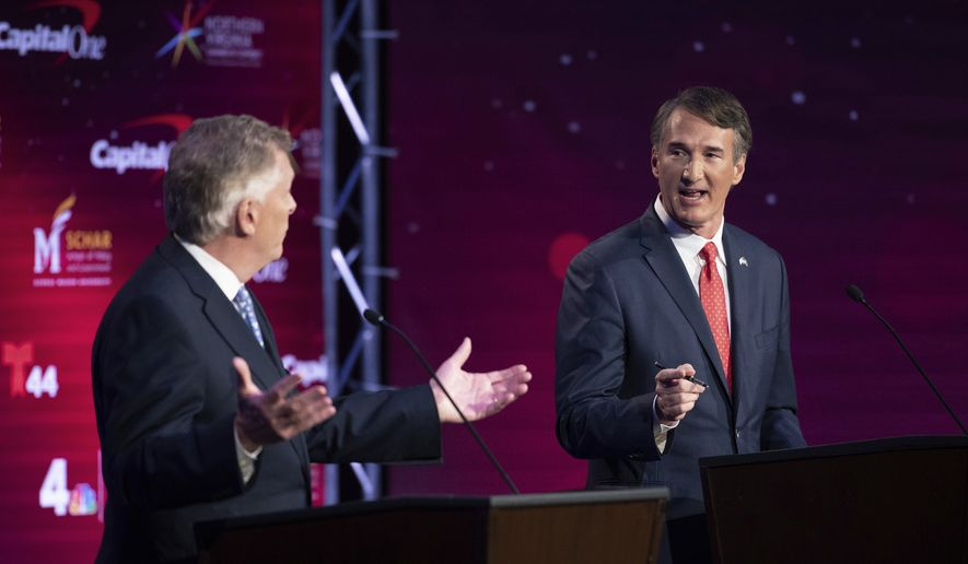 Virginia Democratic gubernatorial candidate and former Gov. Terry McAuliffe, left, and Republican challenger, Glenn Youngkin, participate in their debate at Northern Virginia Community College, in Alexandria, Va., Tuesday, Sept. 28, 2021. (AP Photo/Cliff Owen) ** FILE **
