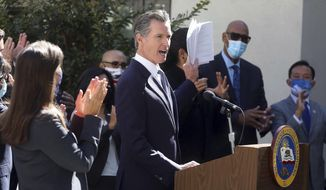 California Gov. Gavin Newsom speaks at a news conference to sign a number of housing bills at the Coliseum Connections apartment complex in Oakland, Calif., Tuesday, Sept. 28, 2021. Newsom signed seven new laws aimed at addressing the state's homeless crisis during an event in Los Angeles, on Wednesday, Sept. 29. (Aric Crabb/Bay Area News Group via AP)