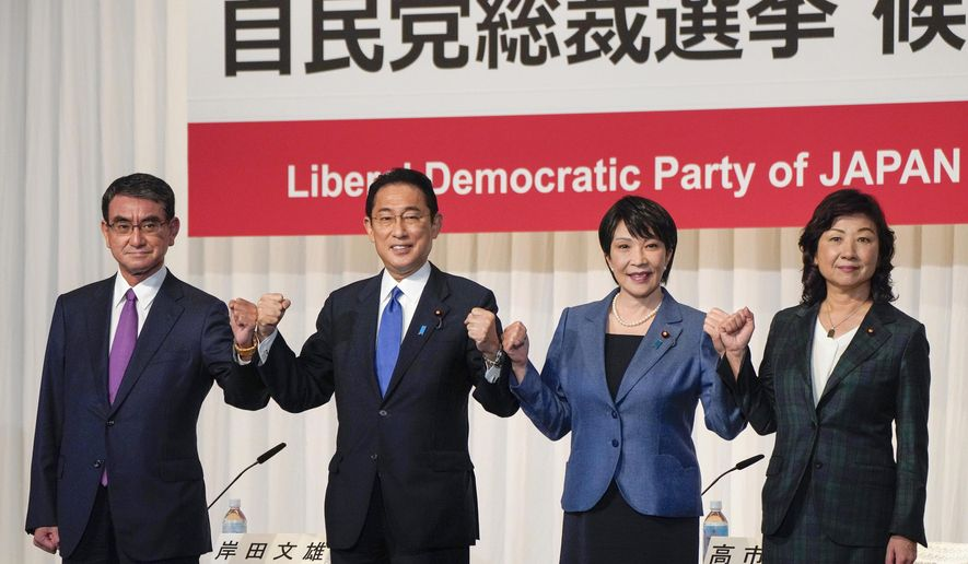 In this Sept. 17, 2021, file photo, candidates for the presidential election of the ruling Liberal Democratic Party pose prior to a joint news conference at the party's headquarters in Tokyo. Japan's governing party will vote Wednesday, Sept. 29, 2021, to pick its new leader who is presumed next prime minister with crucial tasks such as addressing a pandemic-hit economy and ensuring strong alliance with Washington amid growing security risks from China and North Korea. The contenders are, from left to right, Taro Kono, the cabinet minister in charge of vaccinations, Fumio Kishida, former foreign minister, Sanae Takaichi, former internal affairs minister, and Seiko Noda, former internal affairs minister. (Kimimasa Mayama/Pool Photo via AP, File)