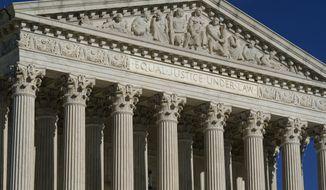 This Friday, Sept. 3, 2021, photo shows the Supreme Court in Washington. (AP Photo/J. Scott Applewhite) ** FILE **