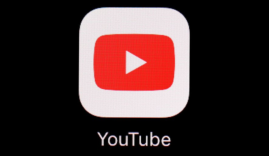 This March 20, 2018, file photo shows the YouTube app on an iPad in Baltimore. Video-sharing tech platform YouTube on Wednesday, Sept. 29, 2021, announced immediate bans on false claims that vaccines are dangerous and cause health issues like autism, cancer or infertility.    (AP Photo/Patrick Semansky, File)