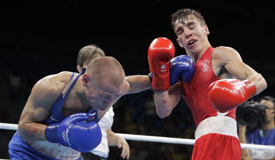 Russia's Vladimir Nikitin, left, fights Ireland's Michael John Conlan during a men's bantamweight 56-kg quarterfinals boxing match at the 2016 Summer Olympics in Rio de Janeiro, Brazil, Tuesday, Aug. 16, 2016. (AP Photo/Jae C. Hong) **FILE**