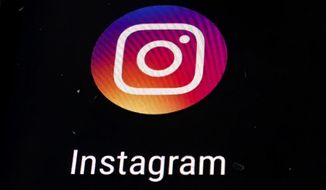 In this Nov. 29, 2018, file photo, the Instagram app logo is displayed on a mobile screen in Los Angeles. Political adversaries in Congress are united in outrage against Facebook for privately compiling information that its Instagram photo-sharing service appeared to grievously harm some teens, especially girls, while publicly downplaying the popular platform's negative impact. Facebook's head of global safety, Antigone Davis, has been summoned to testify for a hearing Thursday, Sept. 30, 2021, by a Senate panel. (AP Photo/Damian Dovarganes, File)