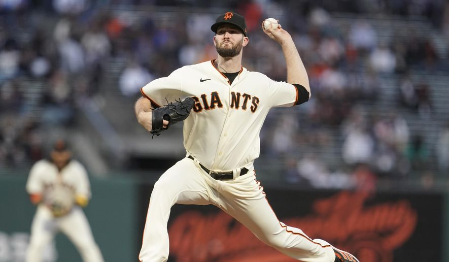 San Francisco Giants' Alex Wood pitches against the Arizona Diamondbacks during the first inning of a baseball game in San Francisco, Wednesday, Sept. 29, 2021. (AP Photo/Jeff Chiu) **FILE**