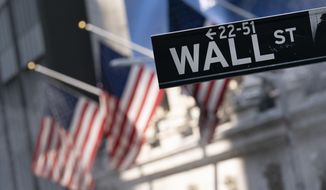 A sign for Wall Street hangs in front of the New York Stock Exchange, July 8, 2021.  Withthe close of the market on Sept. 30, 2021, the S&P index had seen a 4.8% drop in the month of September, making it the worst month for the market since the beginning of the coronavirus pandemic in March 2020. (AP Photo/Mark Lennihan, file) **FILE**