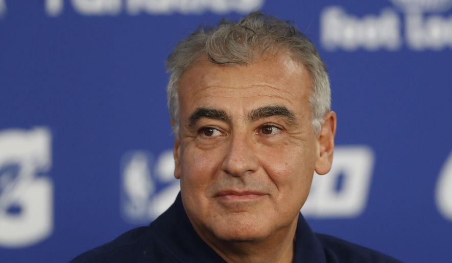 In this Jan. 24, 2020, file photo, Marc Lasry, co-owner of the NBA's Milwaukee Bucks, attends a press conference ahead of NBA basketball game between Charlotte Hornets and Milwaukee Bucks in Paris. Lasry, the hedge-fund billionaire and Milwaukee Bucks co-owner who was named chairman of embattled media organization Ozy earlier this month, has resigned from its board. (AP Photo/Thibault Camus, File)