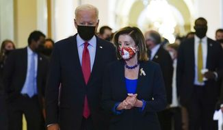 President Joe Biden walks with House Speaker Nancy Pelosi of Calif., on Capitol Hill in Washington, Friday, Oct. 1, 2021, after attending a meeting with the House Democratic caucus to try to resolve an impasse around the bipartisan infrastructure bill. (AP Photo/Susan Walsh)