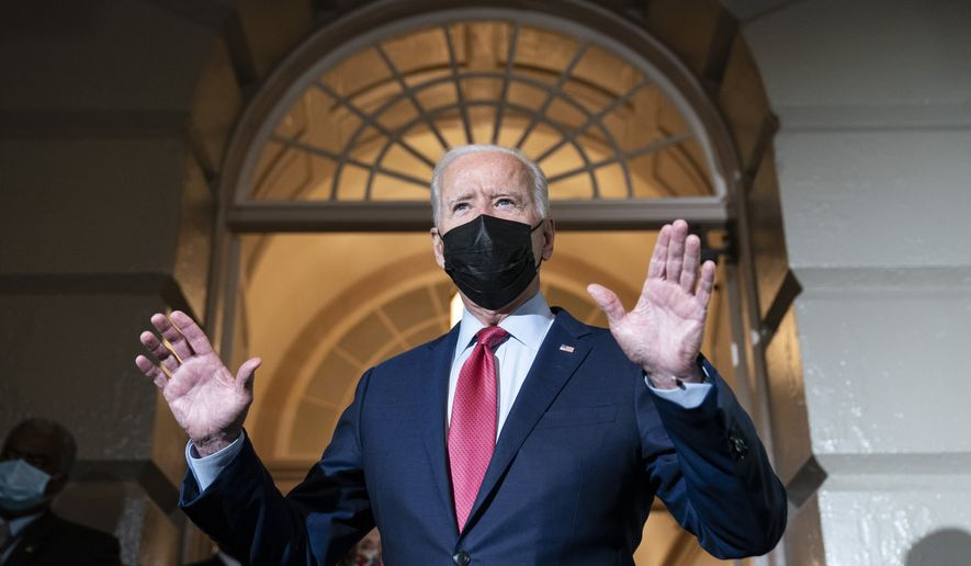 President Joe Biden speaks with reporters as he departs after a House Democratic Caucus meeting on Capitol Hill, Friday, Oct. 1, 2021, in Washington. (AP Photo/Alex Brandon)