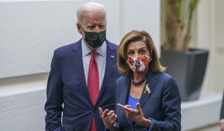 President Joe Biden and Speaker of the House Nancy Pelosi, D-Calif., talk in a basement hallway of the Capitol after meeting with House Democrats to rescue his his $3.5 trillion government overhaul and salvage a related public works bill, in Washington, Friday, Oct. 1, 2021. (AP Photo/J. Scott Applewhite)