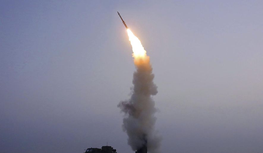 """This photo provided on Oct. 1, 2021, by the North Korean government shows what North Korea claims to be the test firing of a newly developed anti-aircraft missile in North Korea, Thursday, Sept. 30, 2021. Independent journalists were not given access to cover the event depicted in this image distributed by the North Korean government. The content of this image is as provided and cannot be independently verified. Korean language watermark on image as provided by source reads: """"KCNA"""" which is the abbreviation for Korean Central News Agency. (Korean Central News Agency/Korea News Service via AP)"""