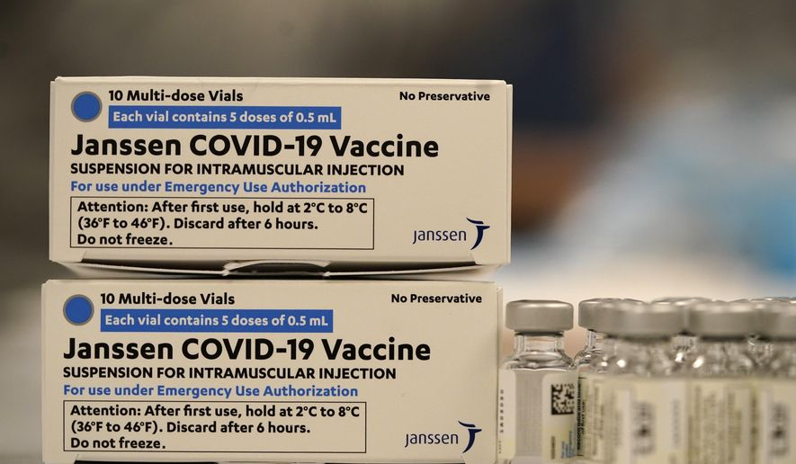Boxes containing the Johnson & Johnson COVID-19 vaccine sit next to vials in the pharmacy of National Jewish Hospital for distribution, in east Denver. (AP Photo/David Zalubowski, File)