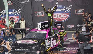 Brandon Brown celebrates in Victory Lane after winning a NASCAR Xfinity Series auto race Saturday, Oct. 2, 2021, in Talladega, Ala. (AP Photo/John Amis)