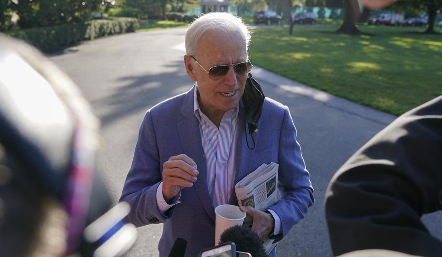 President Joe Biden speaks with members of the press before boarding Marine One on the South Lawn of the White House, Saturday, Oct. 2, 2021, in Washington. Biden is spending the weekend at his home in Delaware. (AP Photo/Patrick Semansky)
