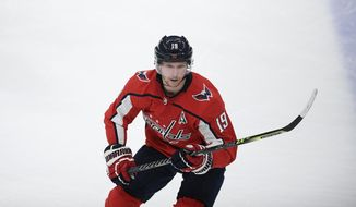 Washington Capitals center Nicklas Backstrom (19) in action during the third period of an NHL hockey game against the Pittsburgh Penguins, Thursday, April 29, 2021, in Washington. Backstrom says he's taking hip injury rehab slowly and has no timetable on when he'll be able to play. Backstrom has not skated during training camp and seems like a long shot to play in the season opener Oct. 13 or soon thereafter. (AP Photo/Nick Wass) **FILE**