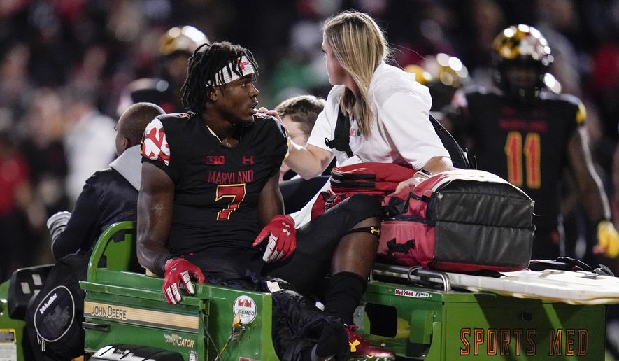 Maryland wide receiver Dontay Demus Jr. is carted off the field during the first half of an NCAA college football game against Iowa, Friday, Oct. 1, 2021, in College Park, Md. (AP Photo/Julio Cortez) **FILE**