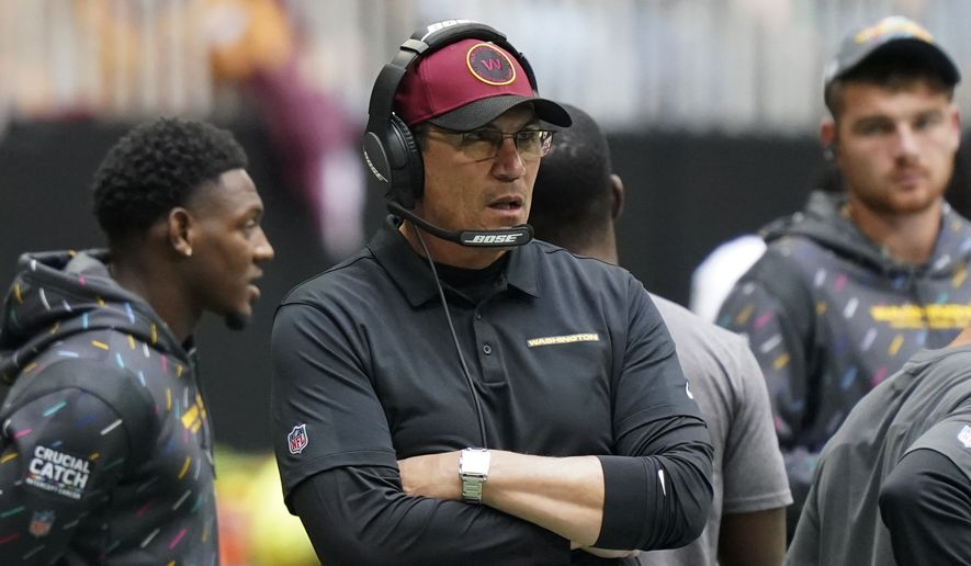 Washington Football Team head coach Ron Rivera watches play against the Atlanta Falcons during the second half of an NFL football game, Sunday, Oct. 3, 2021, in Atlanta. (AP Photo/Brynn Anderson) ** FILE **