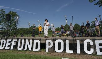 """FILE - In this June 7, 2020, file photo, Alondra Cano, a city council member, speaks during """"The Path Forward"""" meeting at Powderhorn Park in Minneapolis. The focus of the meeting was the defunding of the Minneapolis Police Department. (Jerry Holt/Star Tribune via AP, File)"""