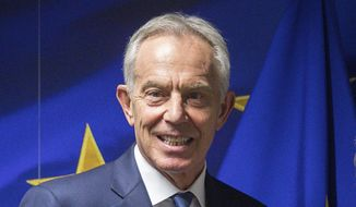 Former British Prime Minister Tony Blair is shown ahead of a meeting at the EU Charlemagne building in Brussels, in this Wednesday, Nov. 6, 2019, file photo. Hundreds of world leaders, powerful politicians, billionaires, celebrities, religious leaders and drug dealers have been stashing away their investments in mansions, exclusive beachfront property, yachts and other assets for the past quarter century, according to a review of nearly 12 million files obtained from 14 different firms located around the world. The report released Sunday, Oct. 3, 2021, by the International Consortium of Investigative Journalists involved 600 journalists from 150 media outlets in 117 countries. Former British Prime Minister Tony Blair is one of 330 current and former politicians identified as beneficiaries of the secret accounts. (Stephanie Lecocq/Pool via AP, File)