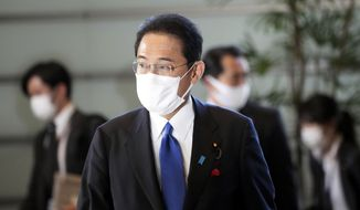 Japan's Prime Minister-elect Fumio Kishida arrives at his official residence Monday, Oct. 4, 2021, in Tokyo. Kishida was elected Japan's prime minister in a parliamentary vote Monday and will be tasked with quickly tackling the pandemic and other domestic and global challenges and leading a national election within weeks. (AP Photo/Eugene Hoshiko)