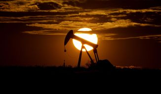 In this Wednesday, April 8, 2020, file photo, the sun sets behind an idle pump jack near Karnes City, USA. (AP Photo/Eric Gay, File)