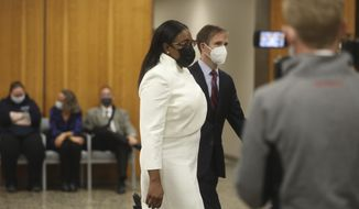 Rochester Mayor Lovely Warren walks towards the courtroom for the start of her trial in Rochester, N.Y., on Monday, Oct. 4, 2021. Warren and two political campaign associates, Rosalind Brooks-Harris and Albert Jones Jr., are charged with breaking campaign finance rules during her 2017 reelection campaign. (Democrat & Chronicle via AP)